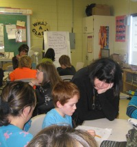 Dr. Marian Small working with students