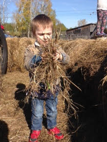 Student playing with straw on excursion